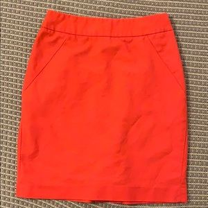 Bright orange pencil skirt